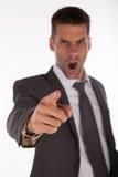 Patron fâché dirigeant le doigt Photographie stock