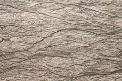 Patronen in het zand van het teruggaande getijde Stock Fotografie
