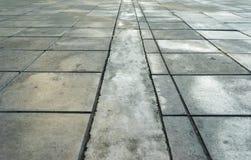 patronen op een tegelvloer of een gang Stock Foto's