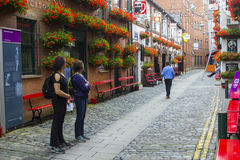 Patrons outside the historic Duke of York pub in Commercial Lane in Belfast, Northern Ireland. Patrons outside the historic tudor style Duke of York pub in Stock Photo