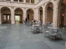 Patrons relax at cafe tables in the Fogg Museum courtyard, Harva. Cambridge, MA, June 12, 2015: Patrons relax at steel cafe tables in the Fogg Art Museum Stock Photos