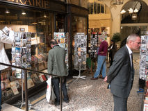 Patrons shop for cards in a Paris arcade Royalty Free Stock Image