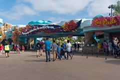 Entrance to sea world san diego california. Patrons visiting the park walk past the promenade of coral architecture Royalty Free Stock Images