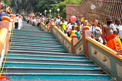 Patrons Walking Down The Stair Of Batu Cave. BATU CAVE, MALAYSIA - January 20 : The middle lane of the stair leading up the cave is left empty for crowd control stock photography