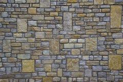 Patroon grijze kleur van de moderne oppervlakte van de de steenmuur van het stijlontwerp decoratieve ongelijke gebarsten echte Stock Afbeelding