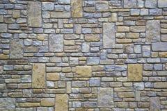 Patroon grijze kleur van de moderne oppervlakte van de de steenmuur van het stijlontwerp decoratieve ongelijke gebarsten echte Royalty-vrije Stock Fotografie
