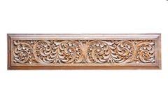 Patroon van bloemen die op houten kader snijden stock afbeelding