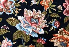 Patroon van een overladen kleurrijk bloementapijtwerk Royalty-vrije Stock Afbeeldingen