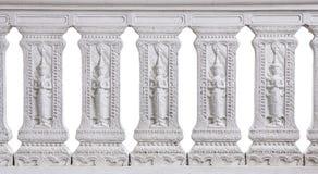 Patroon van Thais die cultuurstandbeeld op witte steenmuur wordt gesneden Royalty-vrije Stock Foto's
