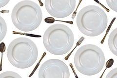 Patroon van uitstekende dinerplaten, messen, vorken en lepels Stock Foto