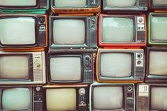 Patroonmuur van stapel kleurrijke retro televisie royalty-vrije stock afbeeldingen