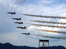 PATROUILLE SUISSE. Airplanes flying on a cloudy sky Royalty Free Stock Photo