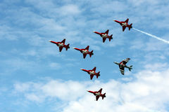Patrouille Suisse acrtobatic team at Payerne Air14. PAYERNE, SWITZERLAND - SEPTEMBER 7: Patrouille Suisse acrobatic team in flight formation over the runaway of Royalty Free Stock Photos