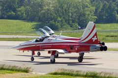Patrouille Suisse airshow aerobatics team. BERLIN, GERMANY - MAY 22: Patrouille Suisse F-5 fighter jets about to take off at the International Aerospace Stock Photos