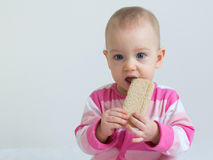 Patrycja eating bread. Infant eating a slice of healthy, crunchy bread Royalty Free Stock Photography