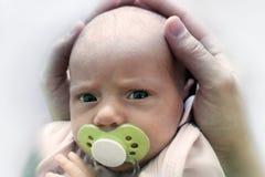 Patrycja mit Baby soother Stockbilder