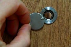 Patrzeć przez peephole Fotografia Stock