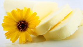 Pats of butter with flower Royalty Free Stock Photography