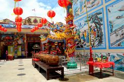 Chinese temple with urns art and red lanterns and Thai flag Pattani Thailand. Pattani, Thailand - May 7, 2016: The courtyard of a traditional Chinese temple in royalty free stock image