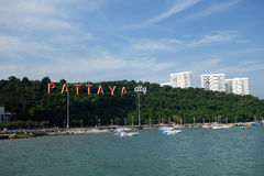 Pattaya bay with commerical boats and the Pattaya City sign Stock Photo