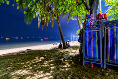 Pattaya beach deck chairs at night with sea Royalty Free Stock Photography