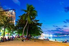 Pattaya beach at night with Hilton hotel Stock Photos