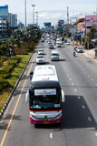 Pattaya vehicle traffic. The Bus and cars passing  Stock Images