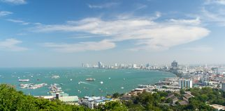 Pattaya City with clear blue sky. Seaside Pattaya city landscape view with clear blue sky and ships in the sea Stock Photo
