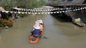 Pattaya Floating Market. Small Tourist Wooden Boat moving along the water. Thailand. PATTAYA, THAILAND, DECEMBER 18, 2017: Pattaya Floating Market. Small Tourist stock video