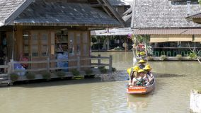 Pattaya Floating Market. Small Tourist Wooden Boat moving along the water. Thailand stock video footage