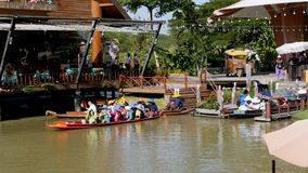Pattaya Floating Market. Small Tourist Wooden Boat moving along the Water. Thailand. PATTAYA, THAILAND, DECEMBER 16, 2017: Pattaya Floating Market. Small Tourist stock video footage