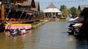 Pattaya Floating Market. Small Tourist Wooden Boat moving along the Water. Thailand. PATTAYA, THAILAND, DECEMBER 16, 2017: Pattaya Floating Market. Small Tourist stock footage