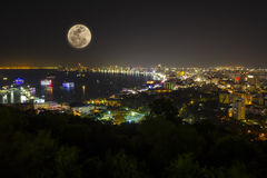 Pattaya full-moon. Night view of Pattaya bay with full moon, Thailand Royalty Free Stock Photo