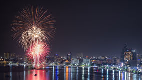 Pattaya International Fireworks 2014. At Pattaya Beach, this picture was captured from the viewpoint of Pra tam Hnak Hill Royalty Free Stock Photo