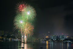 Pattaya International Fireworks 2014. At Pattaya Beach, this picture was captured from the viewpoint of Pra tam Hnak Hill Royalty Free Stock Photography