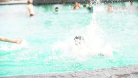 PATTAYA - Mar 30 2016 Happy asian child running and jumping in to the pool at Ambassador City Jomtien Hotel at PATTAYA THAILAND Ma stock video footage