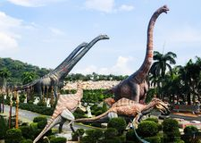 PATTAYA, THAILAND - APRIL 24, 2019 : Tourist visit giant dinosaur Valley at Nong Nooch Garden royalty free stock images