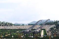 PATTAYA, THAILAND - APRIL 24, 2019 : Tourist visit giant dinosaur Valley at Nong Nooch Garden stock photography