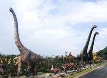 PATTAYA, THAILAND - APRIL 24, 2019 : Tourist visit giant dinosaur Valley at Nong Nooch Garden stock photos