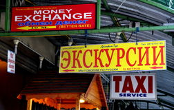 Pattaya, Thailand: Bi-lingual Shop Signs. Bi-lingual signs in English and Russian for the benefit of the many Russian and English speaking tourists hang from Stock Photo