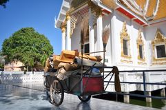 Cart of cleaning staff outside Buddhist temple royalty free stock photo