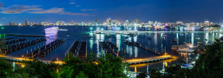 Pattaya, Thailand - circa August 2015: Skyline of Pattaya, Thailand with bay and boats by  night Stock Photo