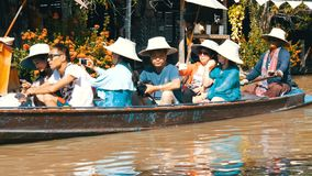 Pattaya, Thailand - December 18, 2017: Excursions for tourists on the floating market. People go boating on a river stock video