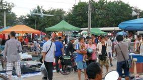 Pattaya, Thailand - December 16, 2017: Flea market in Thailand. People choose things on a flea market. Many second-hand