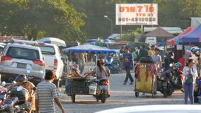 Pattaya, Thailand - December 16, 2017: Flea market in Thailand. People choose things on a flea market. Many second-hand. Pattaya, Thailand - December 16, 2017 stock footage