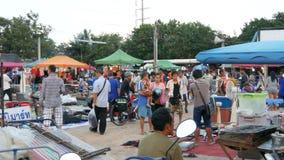 Pattaya, Thailand - December 16, 2017: Flea market in Thailand. People choose things on a flea market. Many second-hand. Pattaya, Thailand - December 16, 2017 stock video