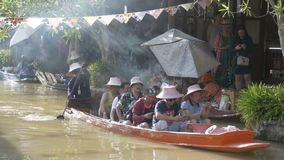 Pattaya Floating Market. Small Tourist Wooden Boat moving along the Water. Thailand. PATTAYA, THAILAND, DECEMBER 16, 2017: Pattaya Floating Market. Small Tourist stock video