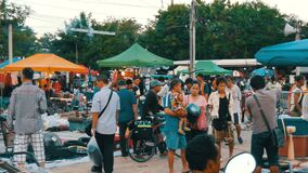 Pattaya, Thailand - December 16, 2017: Many second-hand things on the floor. Flea market in Thailand. People choose