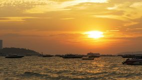Red Sunset on the Sea with Boats Swaying on the Waves. Thailand. Pattaya. PATTAYA, THAILAND, DECEMBER 24, 2017: Red Sunset on the sea with boats swaying on the stock footage