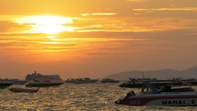 Red Sunset on the Sea with Boats Swaying on the Waves. Thailand. Pattaya. PATTAYA, THAILAND, DECEMBER 24, 2017: Red Sunset on the sea with boats swaying on the stock video